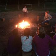 Singing around the camp fire, Breanna taking the lead 0