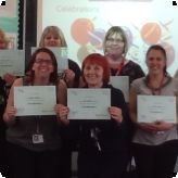 LSAs from the GLC celebrate their success at 'First Class at Number 1' training...