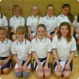 Year 6 pupils receive high five praise from netball coach...
